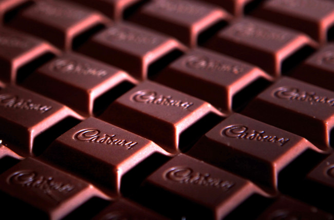 A bar of Cadbury's Dairy Milk chocolate arranged for a photograph in Islington, London, U.K., on Monday, Feb. 23, 2009. Cadbury announce full-year earnings on Wednesday. Photographer: Jason Alden/Bloomberg News