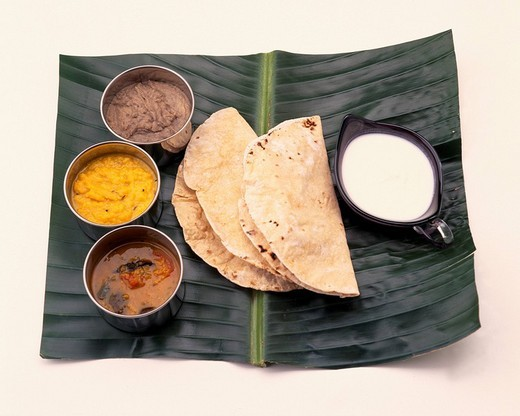 Indian breakfast chapati dull lassi two sorts of curries