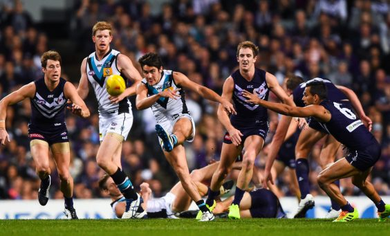 Chad Wingard of the Port Adelaide Power clears with a kick during the AFL 2014 First Semi Final match between the Fremantle Dockers and Port Adelaide Power at Patersons Stadium, Perth on September 13, 2014. (Photo: Daniel Carson/AFL Media)