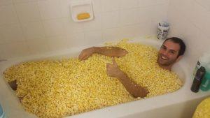 guy-in-bath-full-of-popcorn-corn-13817711991