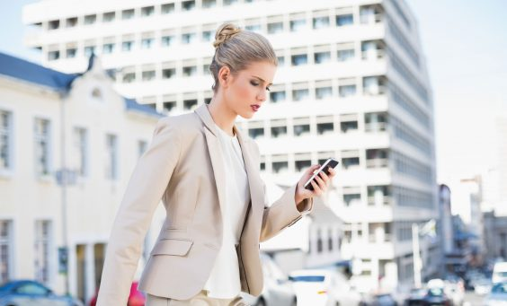 businesswoman-walking-with-smartphone-web