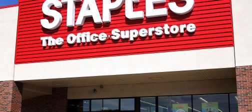 MOUNT PROSPECT, IL - SEPTEMBER 29:  A shopper departs a Staples store September 29, 2005 in Mount Prospect, Illinois. Staples is the first large chain store to begin recycling discarded electronic items, including old cell phones, pagers, portable handheld devices and used printer-ink cartridges.  (Photo by Tim Boyle/Getty Images)