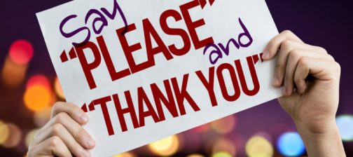 "Say ""Please"" and ""Thank You"" placard with night lights on background"